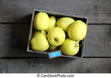 healthy food idea, text and apples on a table