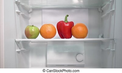 Healthy Food in the Fridge - Timelapse of man substituting...