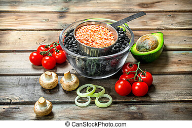 Healthy food. Legumes with organic vegetables .