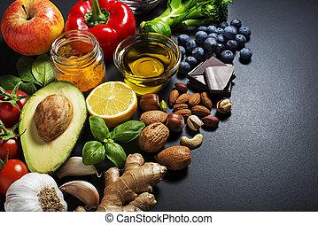 Healthy food - Mixed of fresh healthy food on dark...
