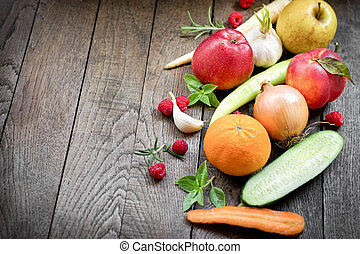 Healthy food - Organic fruit and vegetable on rustic table