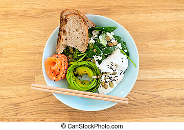 Healthy food. Salad with fish. Wood background.