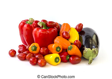 Healthy food, vegetable, paprika, eggplant and tomatos on a white background