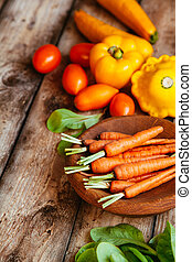 Healthy food. Vegetables on a wooden background.
