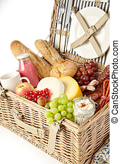 Healthy fresh fruit, bread and cheese in a hamper
