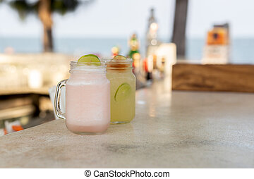 Healthy fresh lychee and lemon drink with slice of lime.