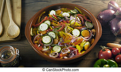 Healthy fresh mixed vegetables in a clay pot