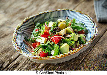Healthy fresh salad with vegetables in a bowl