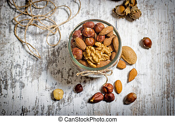 Healthy fruit - nuts on rustic table