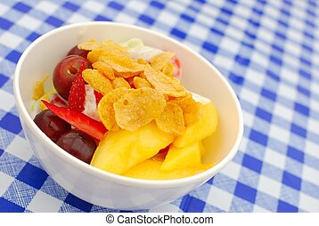 Healthy fruit salad topped with cereal