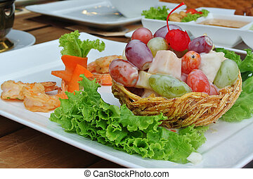 healthy fruit salad with fried shrimp