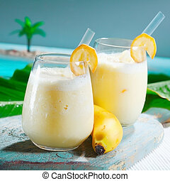 Healthy fruity banana smoothie - Closeup of two glasses of ...