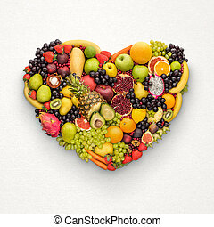 Healthy fruity heart. - Healthy eating food concept; heart ...