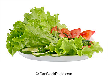 Healthy garden salad with tomatoes and cucumbers and salad leaves. Objects over white.