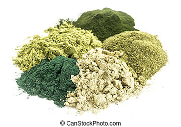 healthy green dietary supplements - a pile of five healthy...