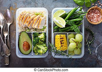 Healthy green meal prep containers with rice and vegetables...