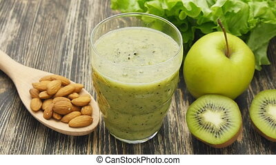 Healthy green smoothie with kiwi, apple and