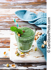 Healthy green smoothie with mint and pistachios