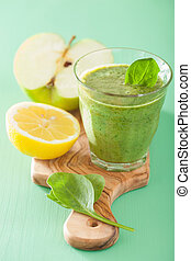 healthy green smoothie with spinach leaves apple lemon
