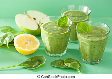 healthy green spinach smoothie with apple lemon