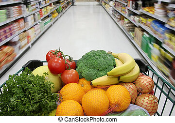 Healthy groceries - Grocery cart filled with nutritious...