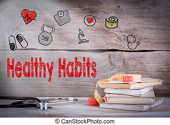 Healthy habits Concept. Stack of books and a stethoscope on a wooden background