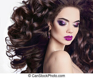 Healthy hair. Bright violet makeup. Beautiful Brunette Girl portrait. Beauty glitter eyeshadow. Model Woman with long blowing hairstyle isolated on white background.
