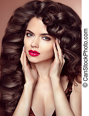 Healthy hair. Makeup. Beautiful brunette girl with long wavy hairstyle
