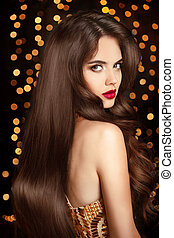 Beautiful brunette girl with long wavy hairstyle