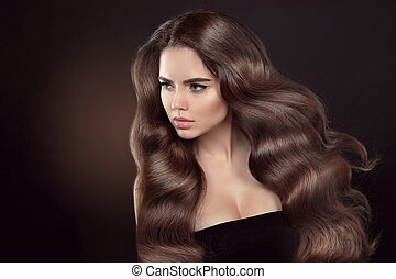 Healthy hair. Wavy hairstyle. Beautiful brunette woman model...