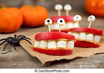 Healthy Halloween apple, marshmallow, peanut butter monster teeth