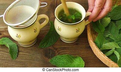 Healthy herb tea prepare. Fresh made Mint Tea