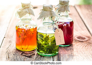 Healthy herbs in bottles as an alternative cure