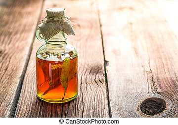 Healthy herbs in bottles as homemade cure
