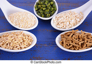 Healthy High Fiber Prebiotic Grains in serving spoons, ...