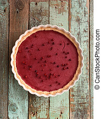 Healthy homemade lingonberry pie on shabby wooden blue background copyspace