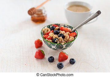 Healthy Homemade Oatmeal with strawberries and blueberries for Breakfast