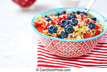 Healthy Homemade Oatmeal with strawberries, blueberries for Breakfast