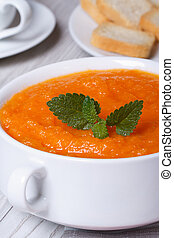 healthy hot cream soup of carrots macro. vertical