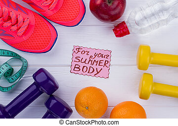 Healthy life accessories on wooden background.