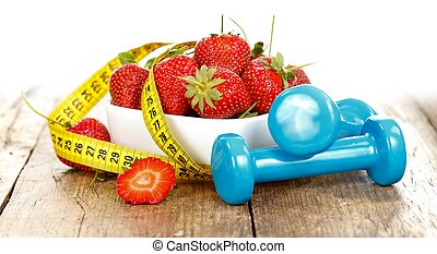 Healthy life - Strawberries with measure tape and weights, ...