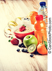 Healthy lifestyle and fitness concept. Fresh fruits, juice and c