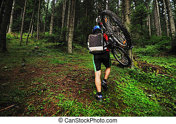 healthy lifestyle and fitness concept with mount bike man outdoor