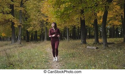 Healthy lifestyle. athletic girl running in the Park and...