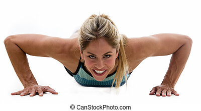 Healthy Lifestyle - Attractive blond woman wearing workout...