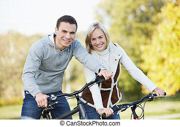 Healthy lifestyle - Attractive couple on bicycles in the...