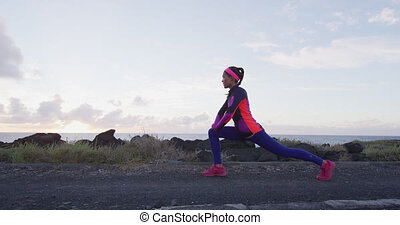 Healthy lifestyle beautiful asian woman stretching legs before running
