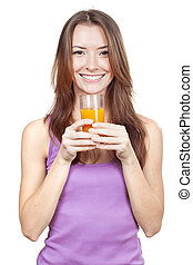 Beautiful brunette woman holding glass of juice