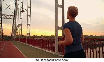 healthy lifestyle concept - unrecognizable jogger female run...