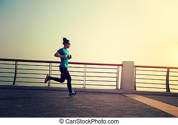 Healthy lifestyle concept, young woman running at seaside